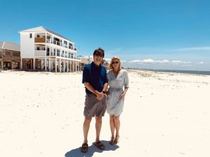 Owner Lebron Lackey and Elizabeth Hart standing on the beach