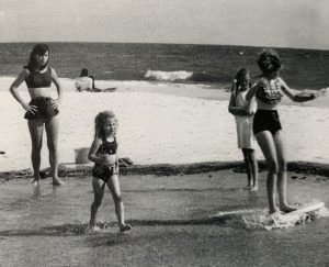 Vintage photo of beachgoers skim-boarding in Mexico Beach